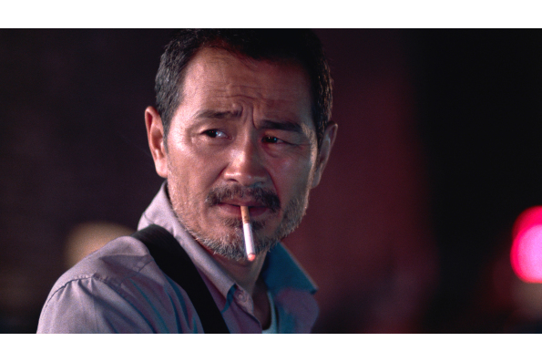 Chen Gang as taxi driver Lao Shi in OLD STONE, a film by Johnny Ma. A Zeitgeist Films release.